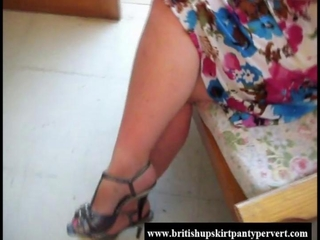 Gorgeous British upskirt milf lifts her skirt and shows her panties
