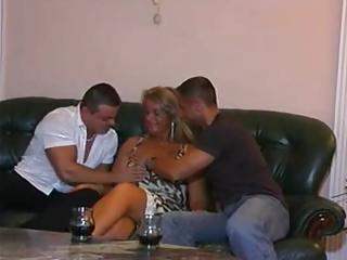 Mature woman and two young men
